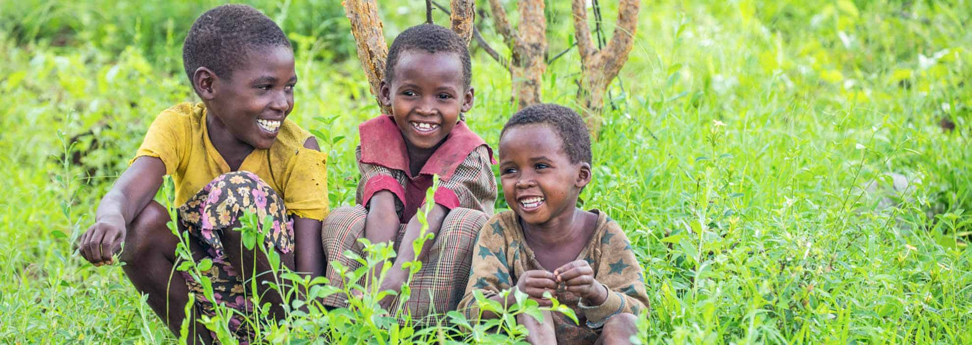 Children in the grass East Africa