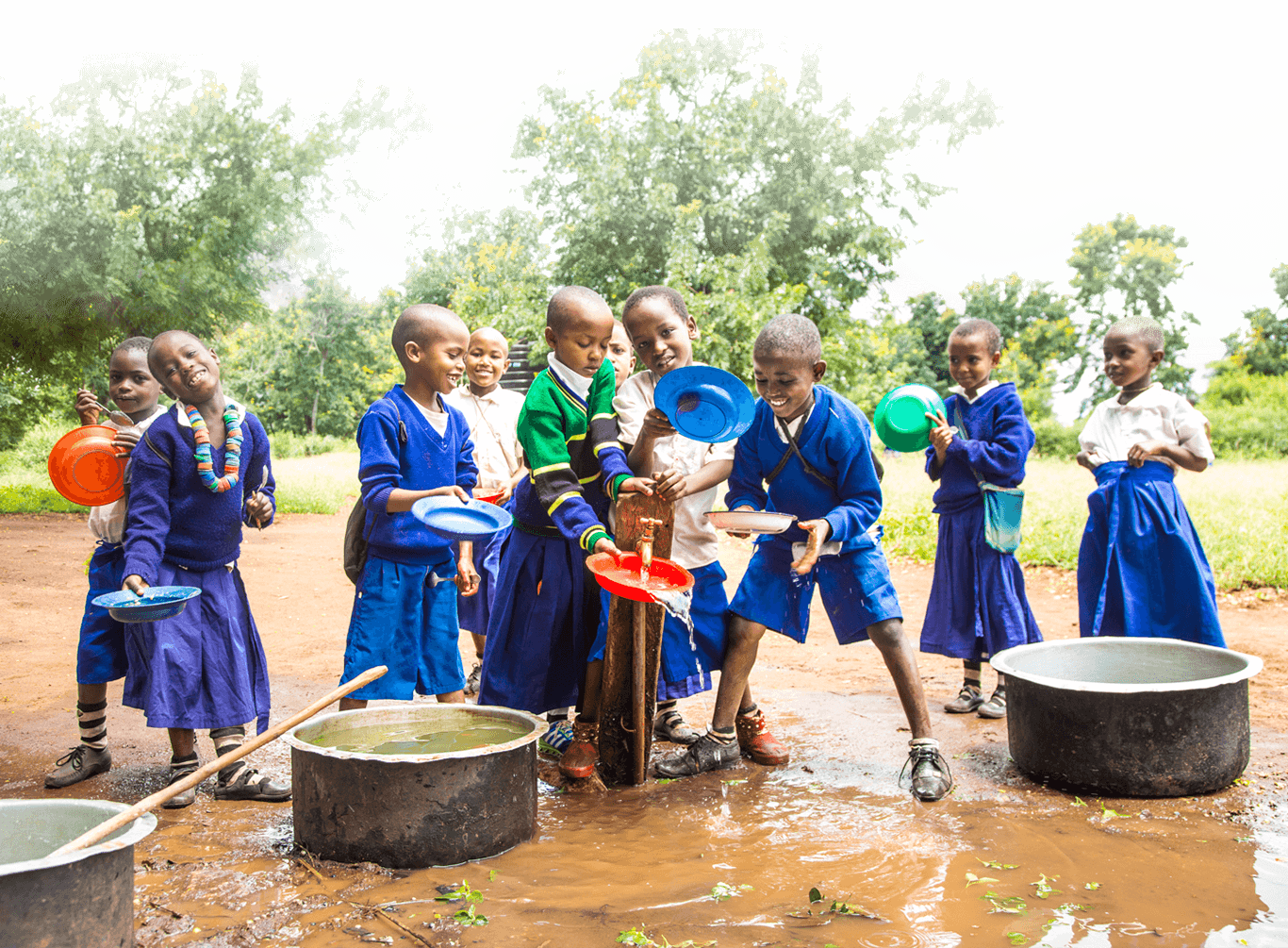Tanzanian students in collaborative So They Can schools