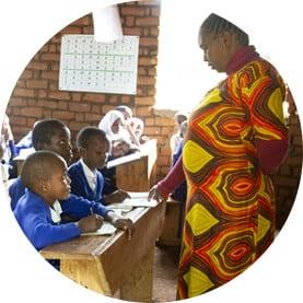 Teacher in East Africa teaching students in class