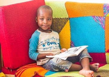 Miti Mingi Village child reading a book