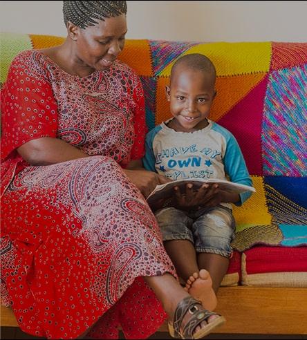 Miti Mingi Mama reading with child