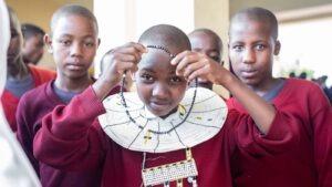 A pupil wearing a masai necklace